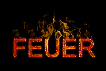 Fire lettering in german burning on fire