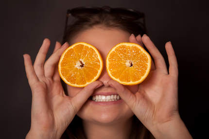 Girl with oranges in the eyes