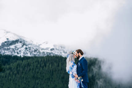 groom in a blue suit and bride in white in the mountains Carpath