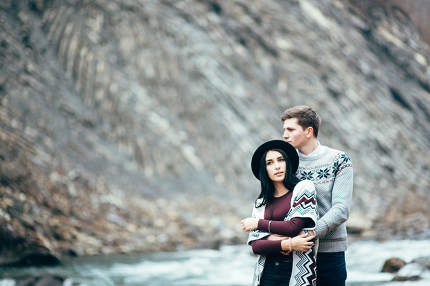 guy and girl along a mountain river