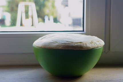 homemade yeast dough for yeast braid on windowsill
