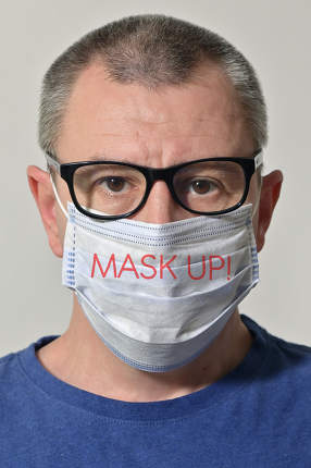Man Wearing Medical Mask With Tagline Words