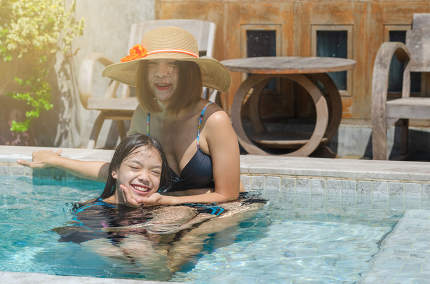 mother and daughter in the pool