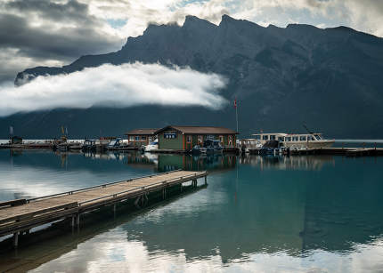 Panoramic image of Lake Minnewanka with early morning mood on August 13, 2019 in Banff National Park, Alberta, Canada