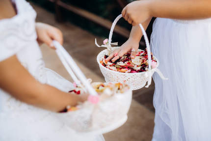 rose petals for the ceremony in wedding baskets