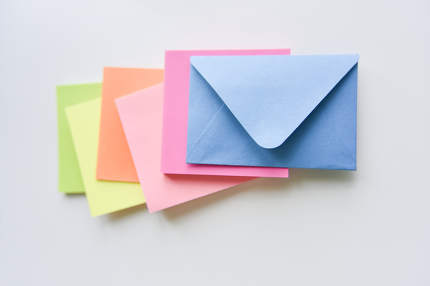 selective focus, blue envelope in the center with colored rectan