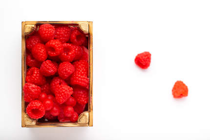 Some raspberries in a small wooden box