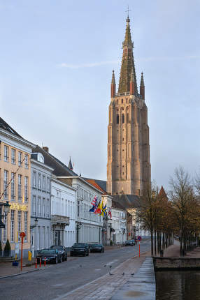 Street onto the church of our Lady, historic city of Bruges on October 31, 2019 in Belgium