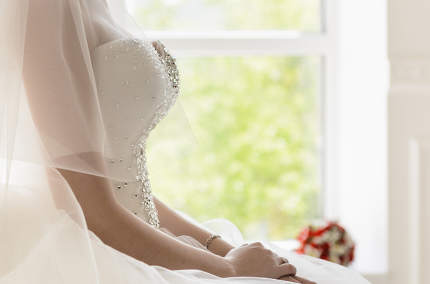 the bride on a white chair