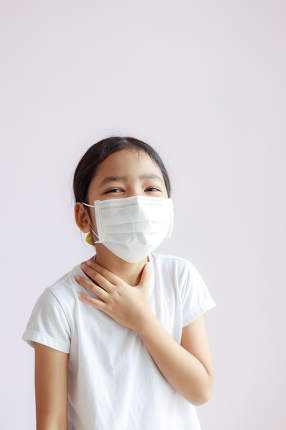 The kid wear a protective medical mask