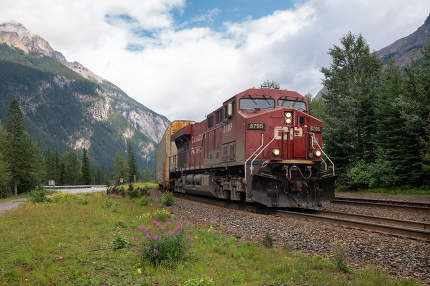 Train of Canadian Pacific Railway crossing the Rocky Mountains close to Field on August 16, 2019 in British Columbia, Canada