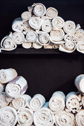 white clean barberman towels rolled into a cylinder