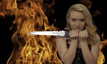 young blonde woman with a knife in the fire