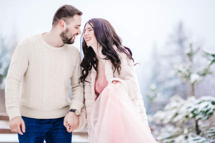young couple on a walk in the snowy mountains