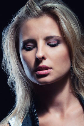 young, girl, blonde, jeans, clothes on a dark background portrai