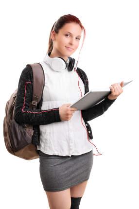 Young girl in schoolgirl uniform holding an open book