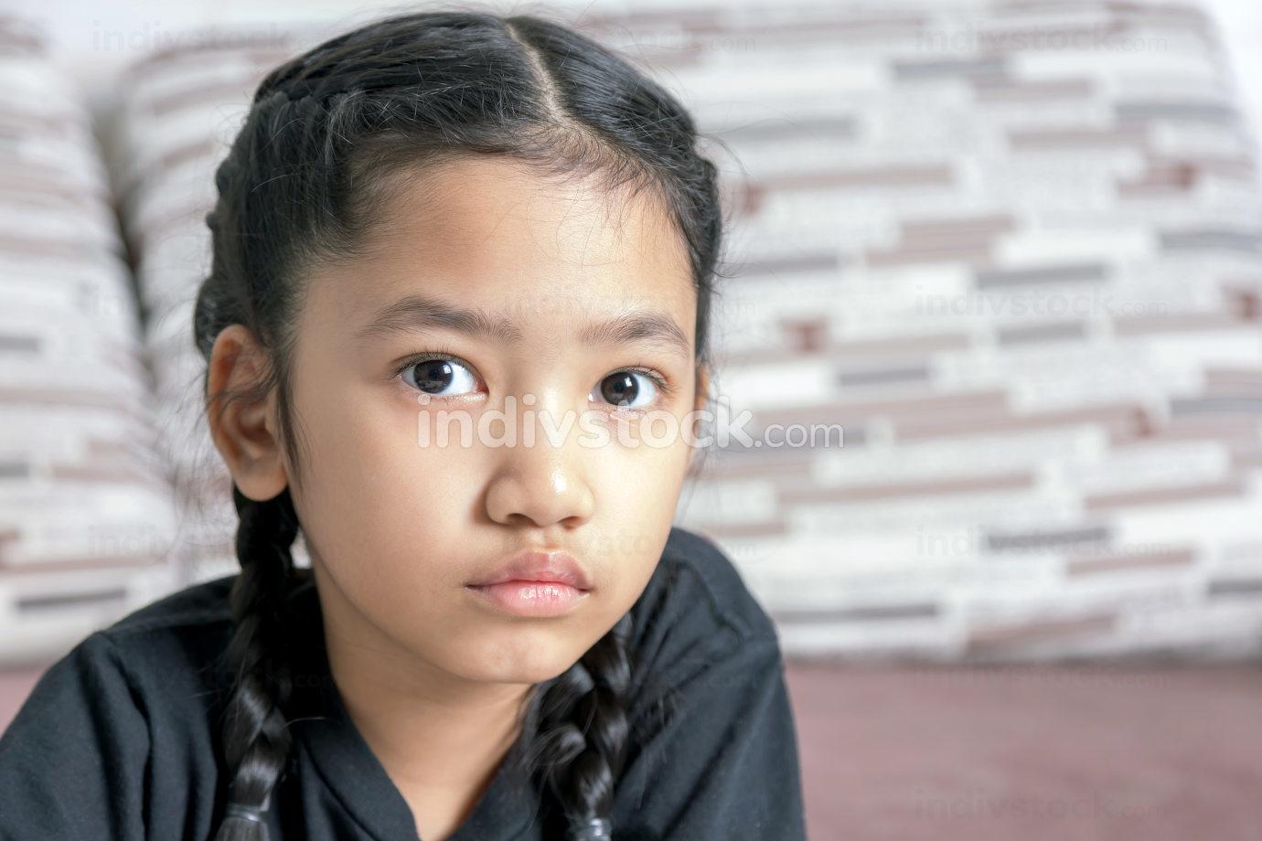 A little Asian girl in a black braid