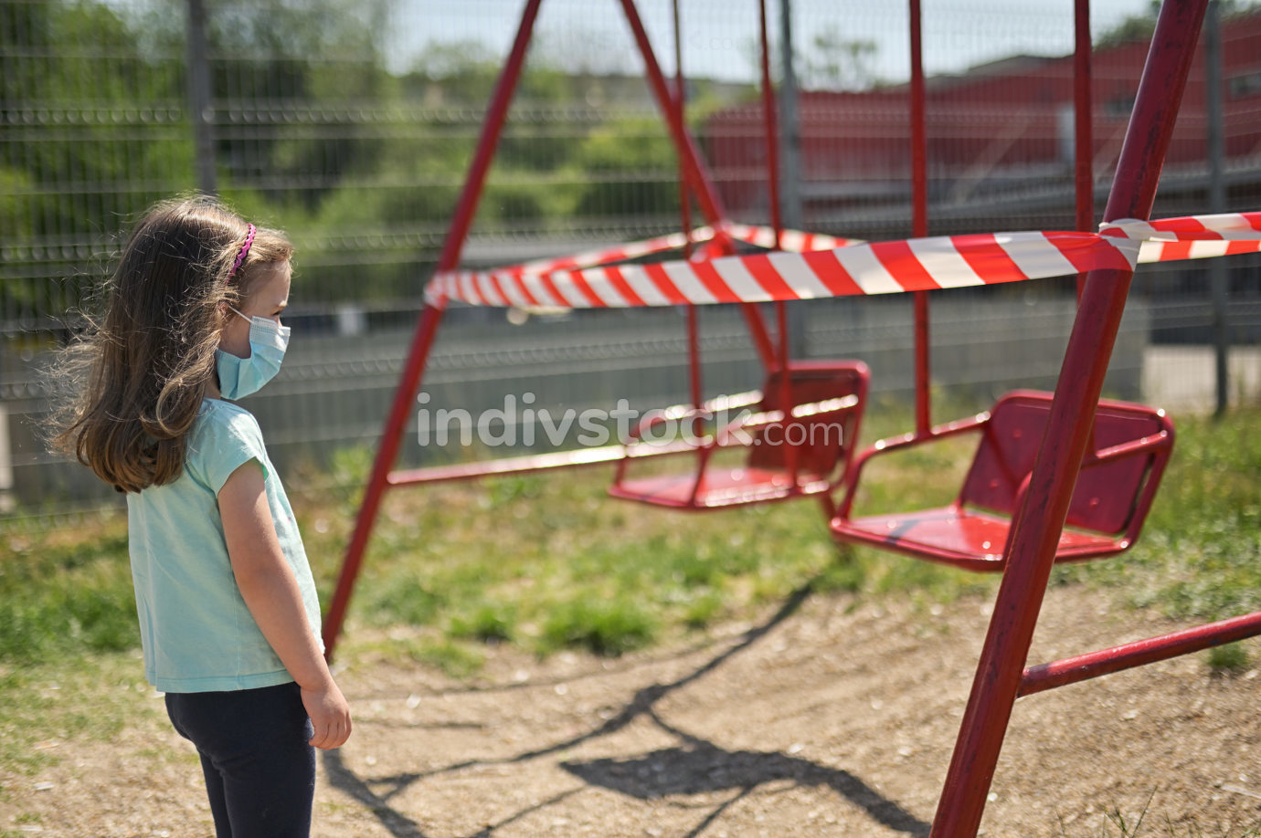 Alone Girl and Children's Swings  Wrapped With Signal Tape