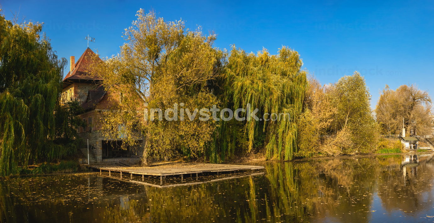 Autumn landscape with a lake and yellow trees