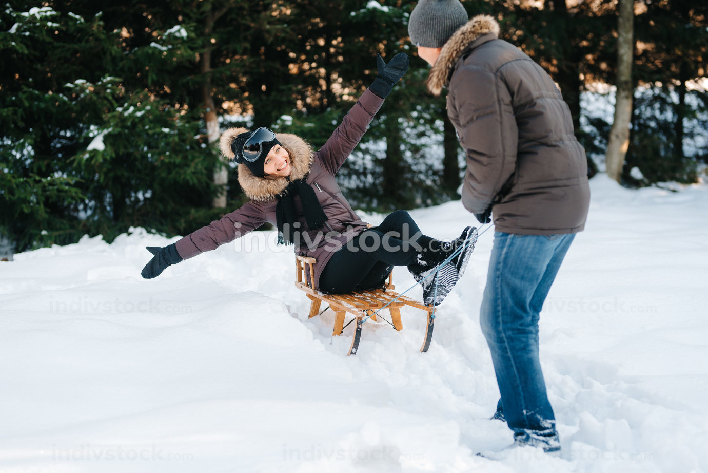 boy and girl outdoors on a winter walk playing snowballs