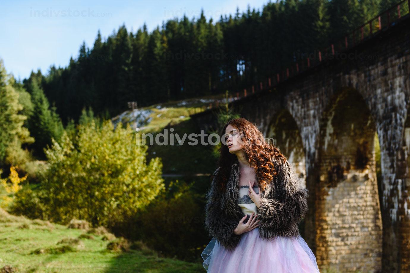 bride walks under a bridge