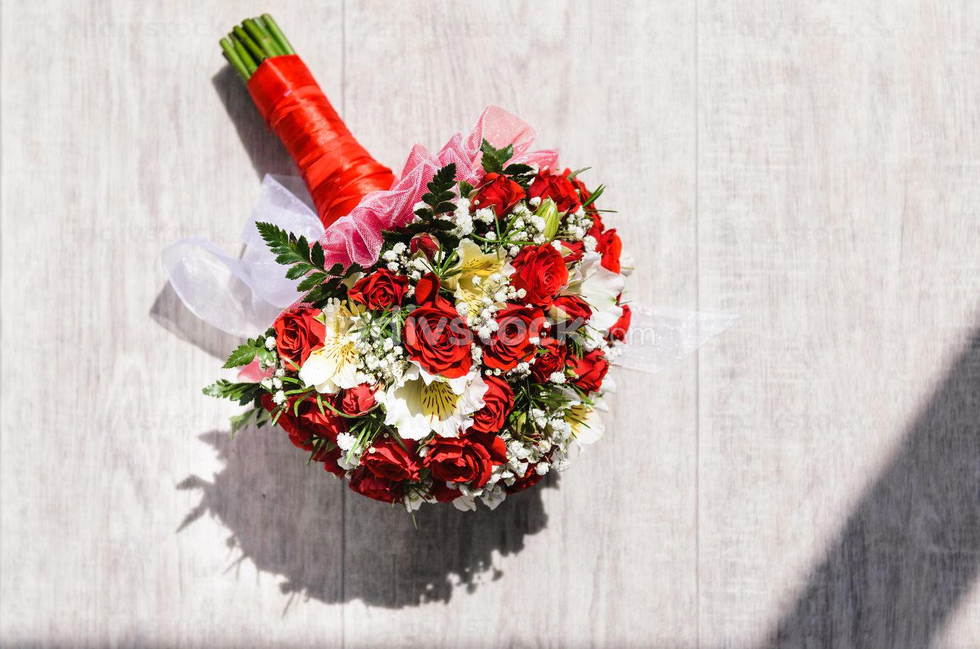 brides bouquet on a vintage wooden floor