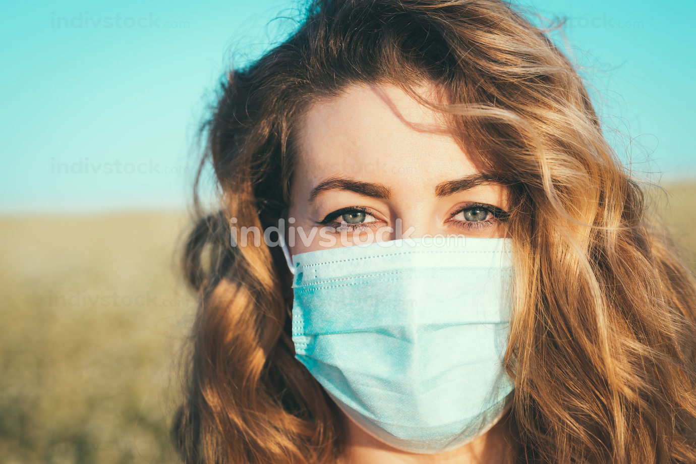 close-up portrait of a woman in a medical mask
