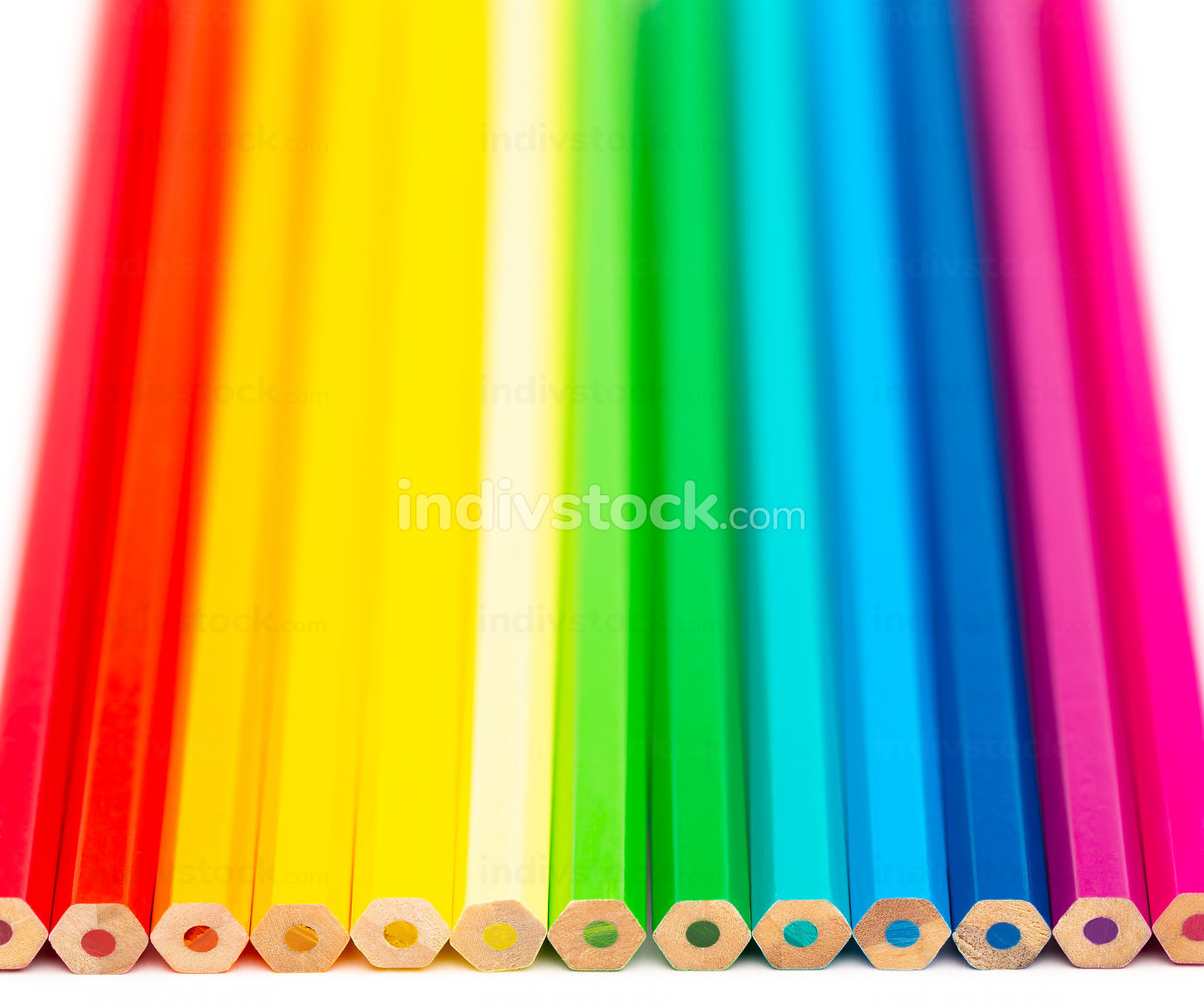 Colorful wooden pencils on a white background