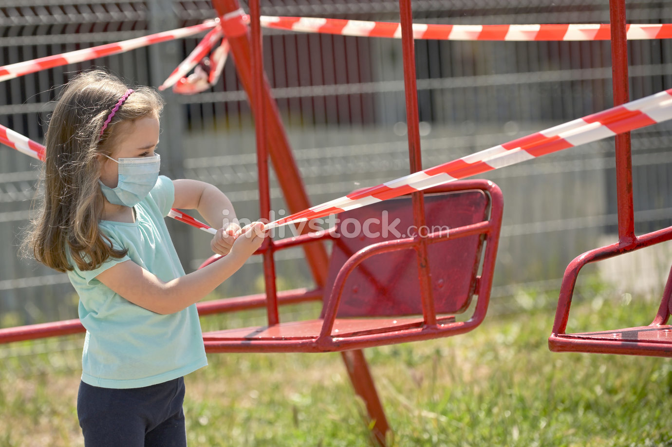 Girl and Swings Wrapped With Signal Tape