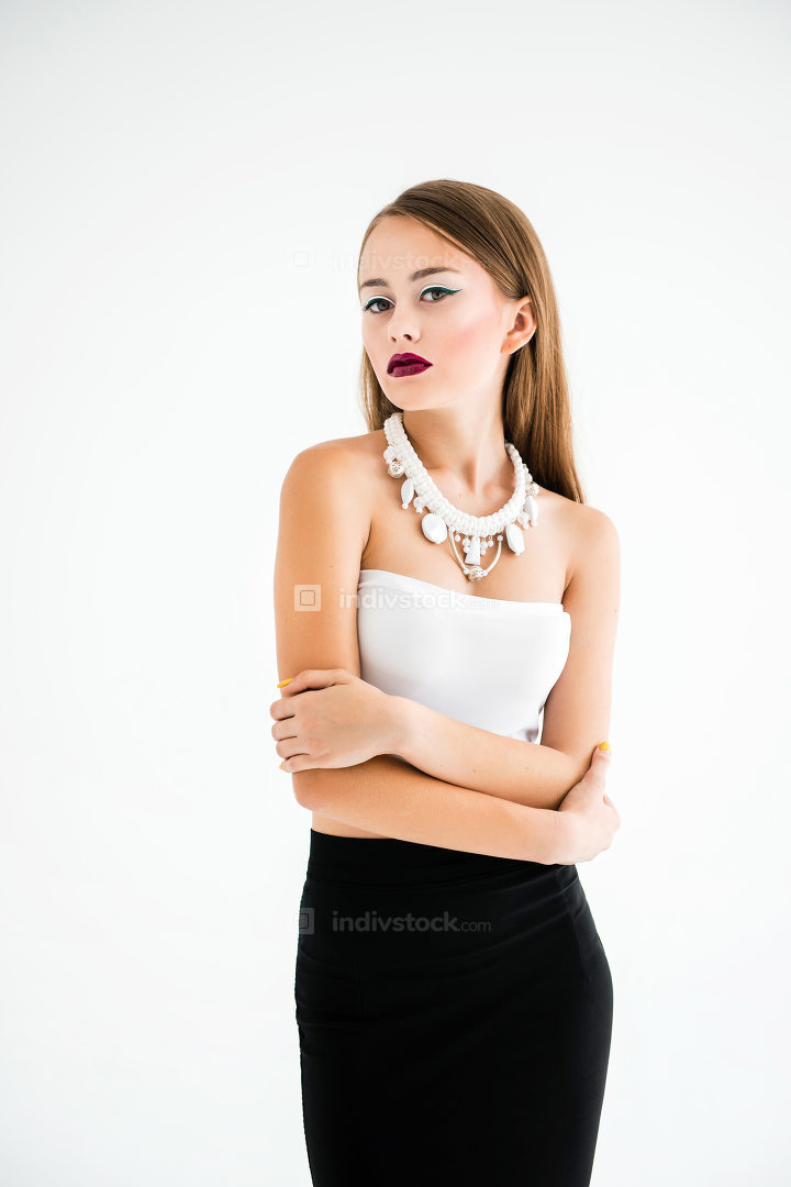girl in a white blouse and black skirt