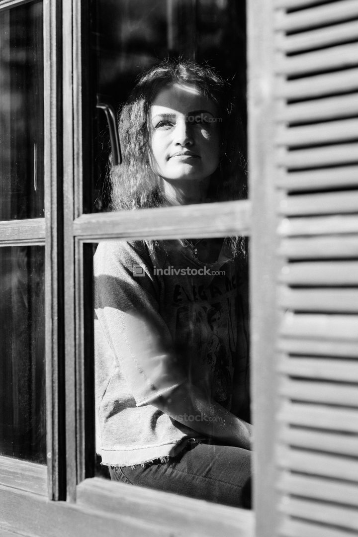girl in the house near the window overlooking