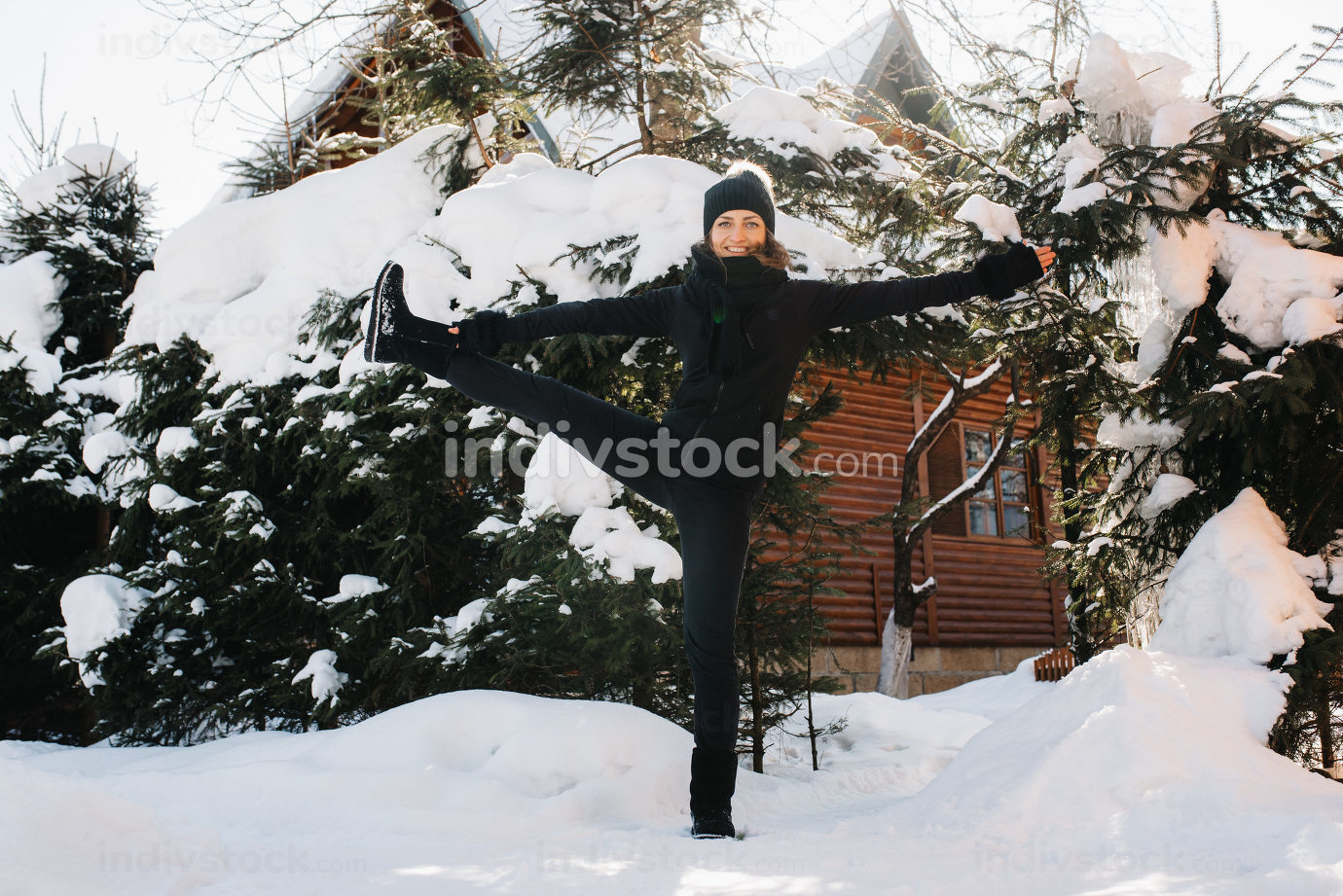girl outdoors on a winter walk playing snowballs