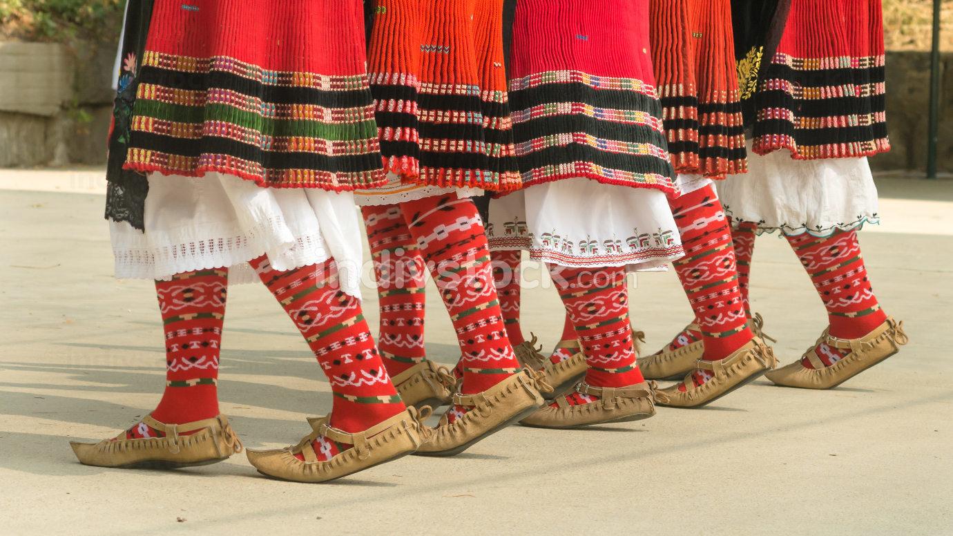 Girls dancing folk dance. People in traditional costumes dance B