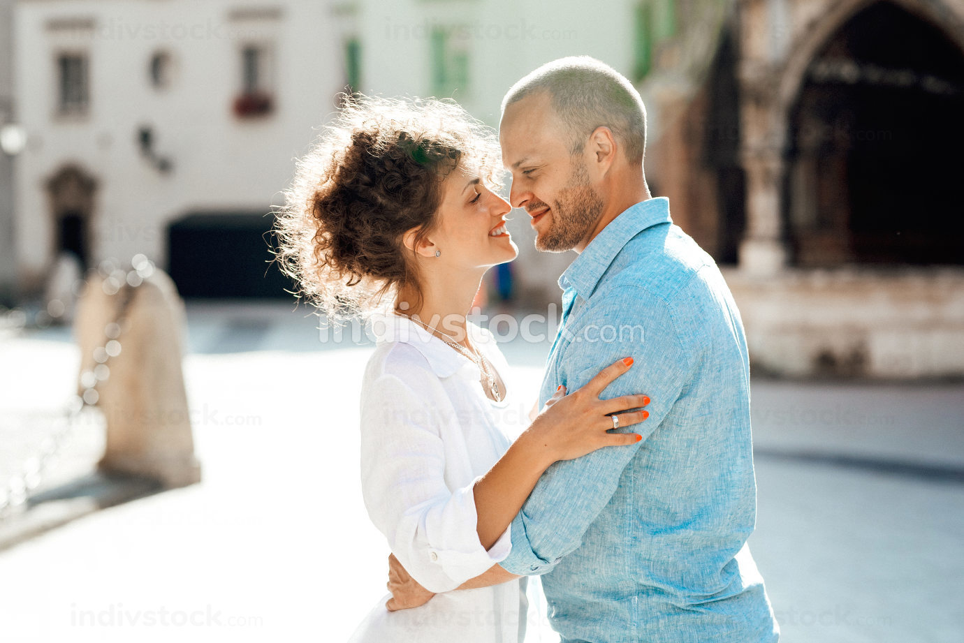 guy and a girl happily walk in the morning on the empty streets