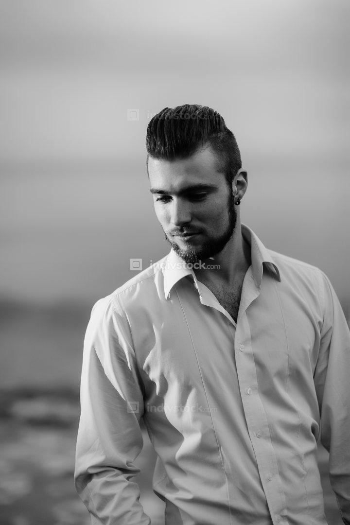 guy with a beard against the sea