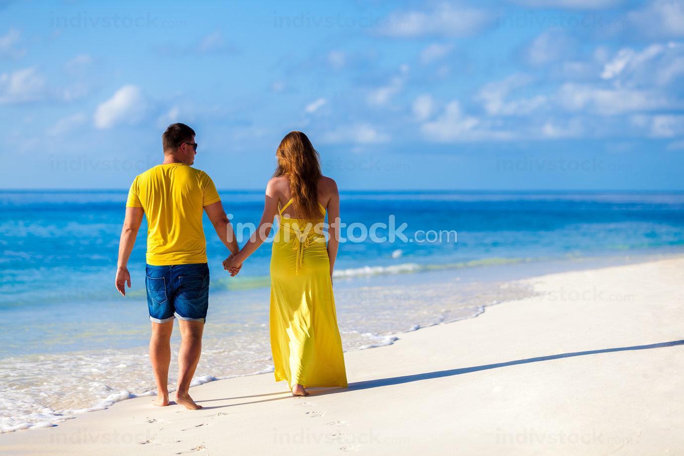 Maldives, a couple walking along the beach