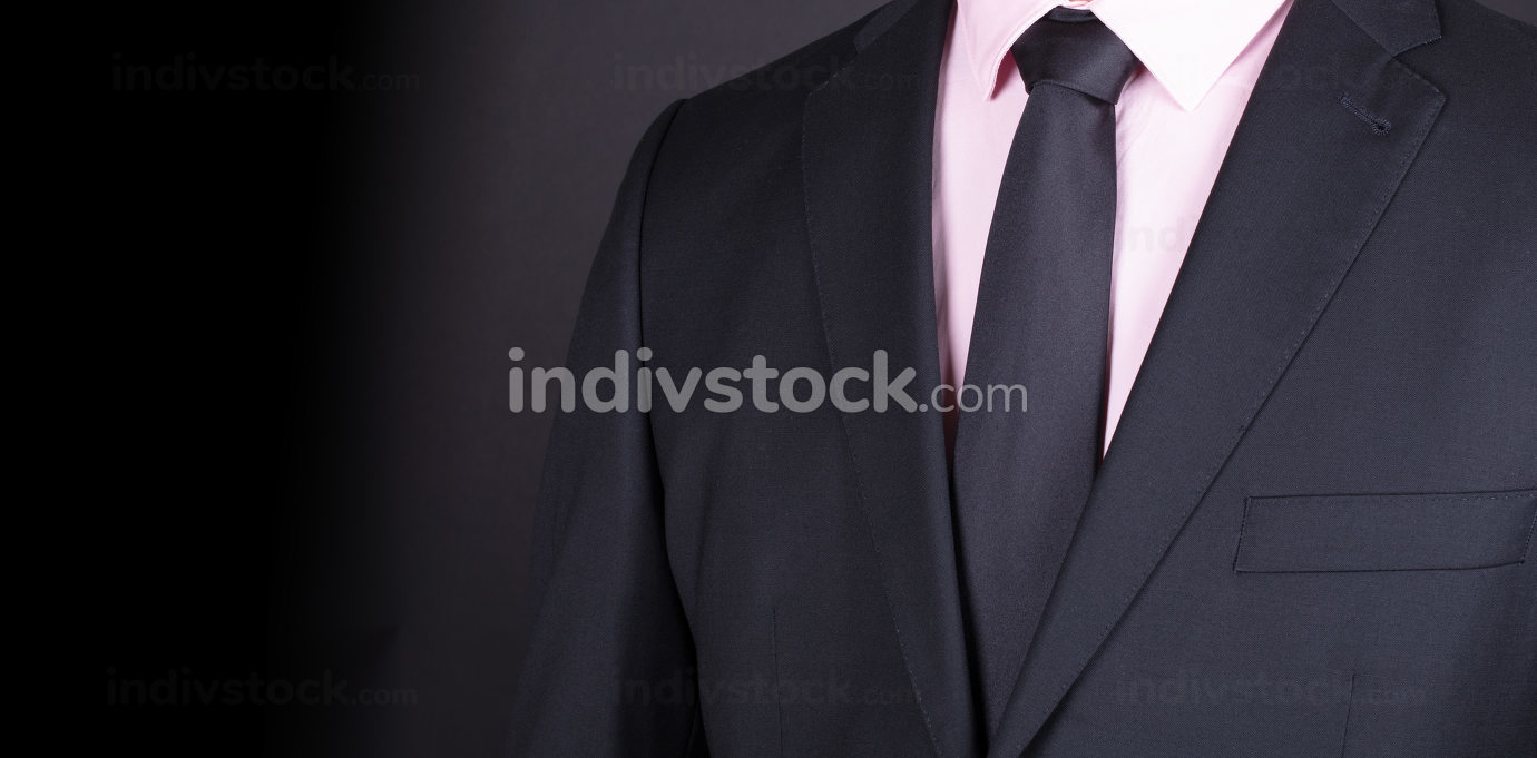 Man in a black suit, close-up