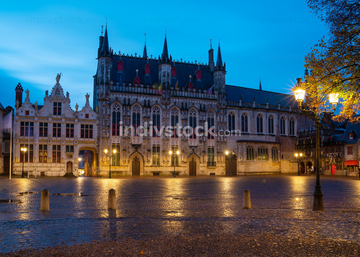 Panoramic image of the historic townhall at daybreak, historic buildings of Bruges on November 2, 2019 in Belgium