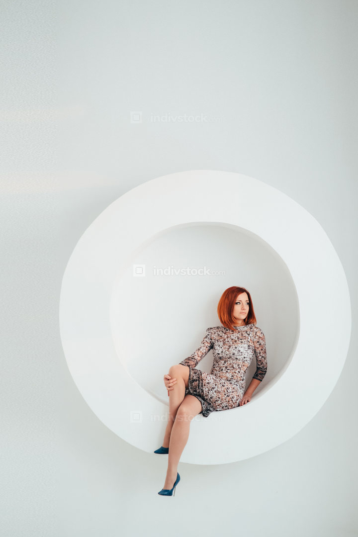 red-haired model girl on a white circle background