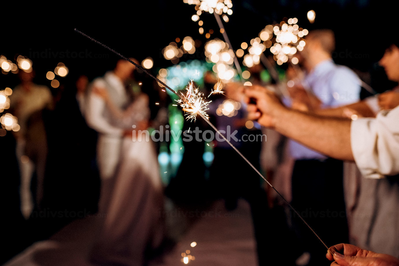 sparklers at the wedding,  on the background