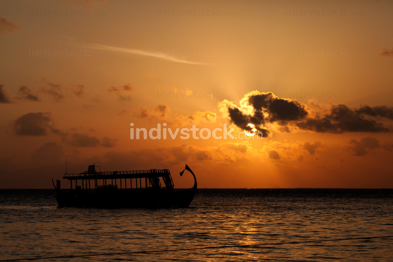 Sunset with a view to the ocean with boats