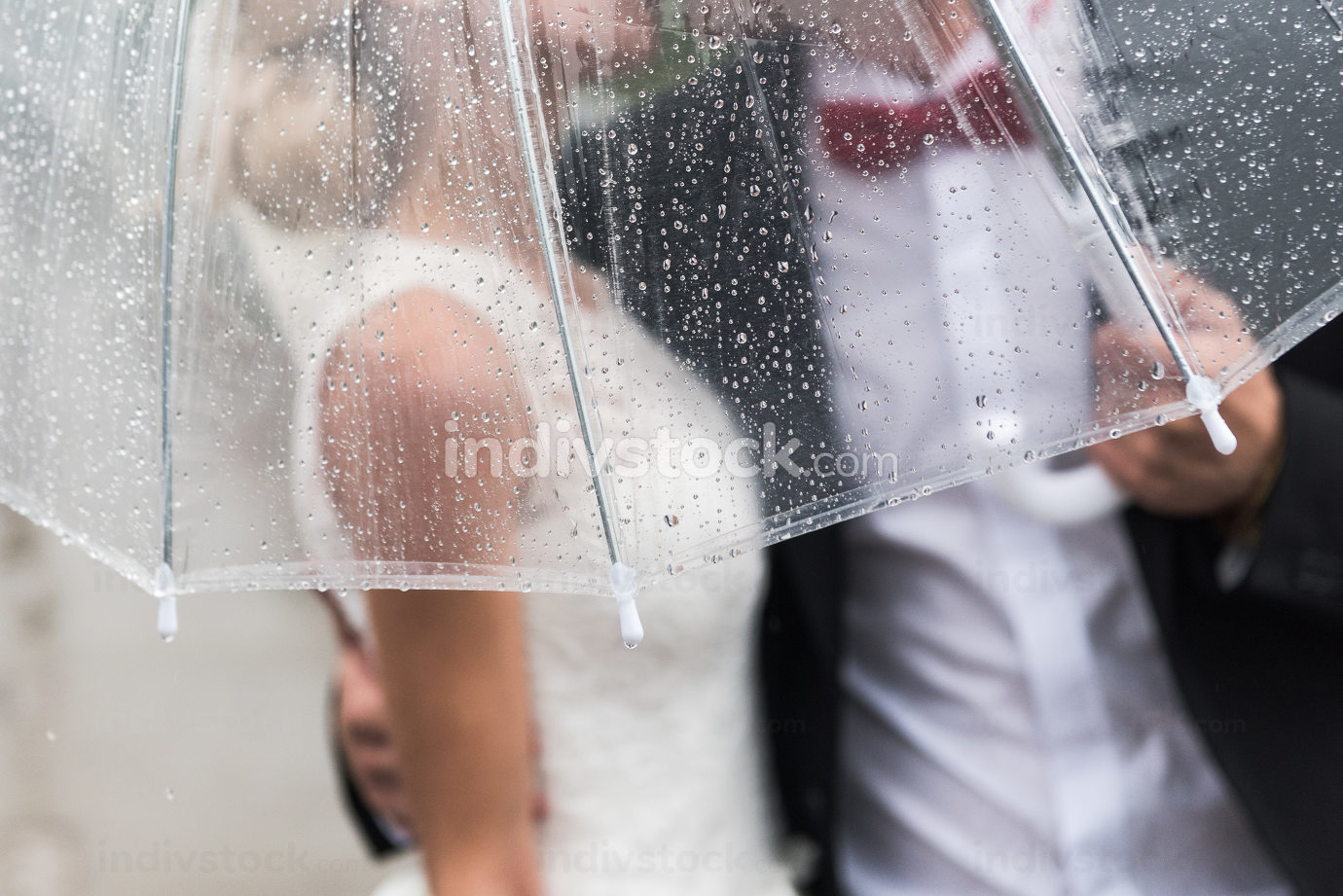 the bride and groom in the rain