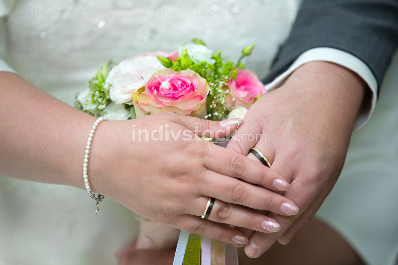 The hands of a newlyweds with the wedding rings