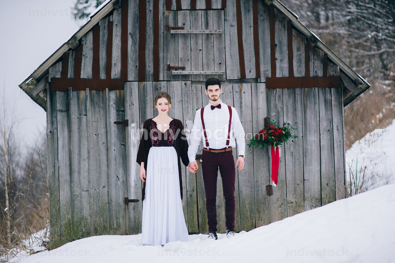 walk the groom and the bride in the Carpathian mountains
