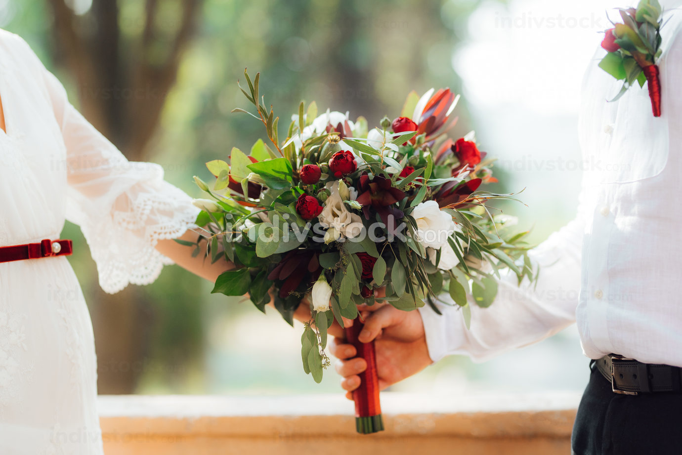 wedding bouquet of red flowers and greenery