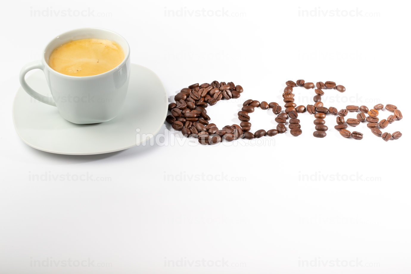 White cup with coffee on a white background and coffee beans
