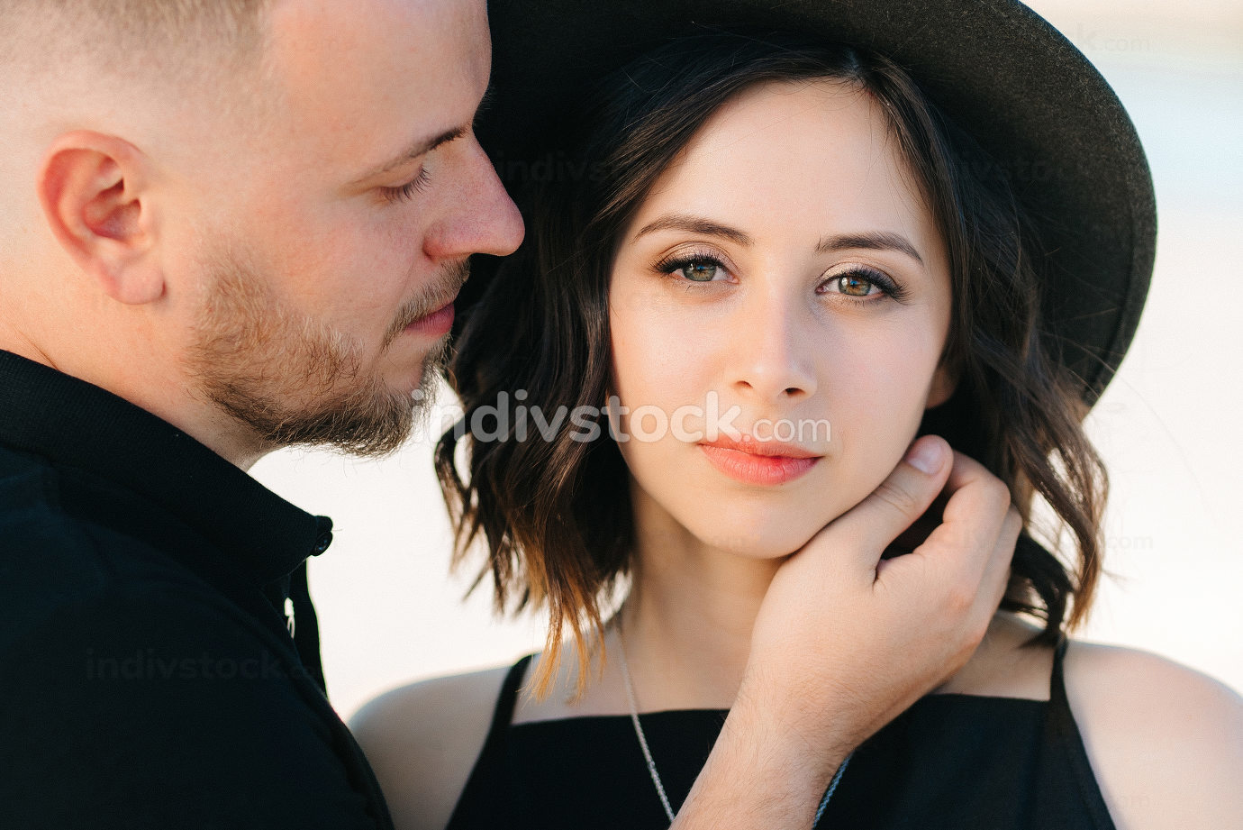young couple a guy and a girl with joyful emotions in black clot