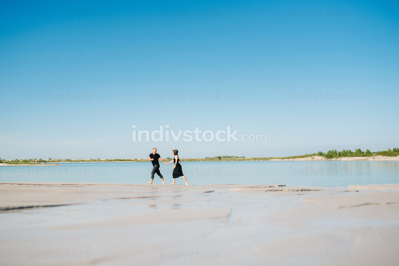 young couple a guy with a girl in black clothes are walking on t