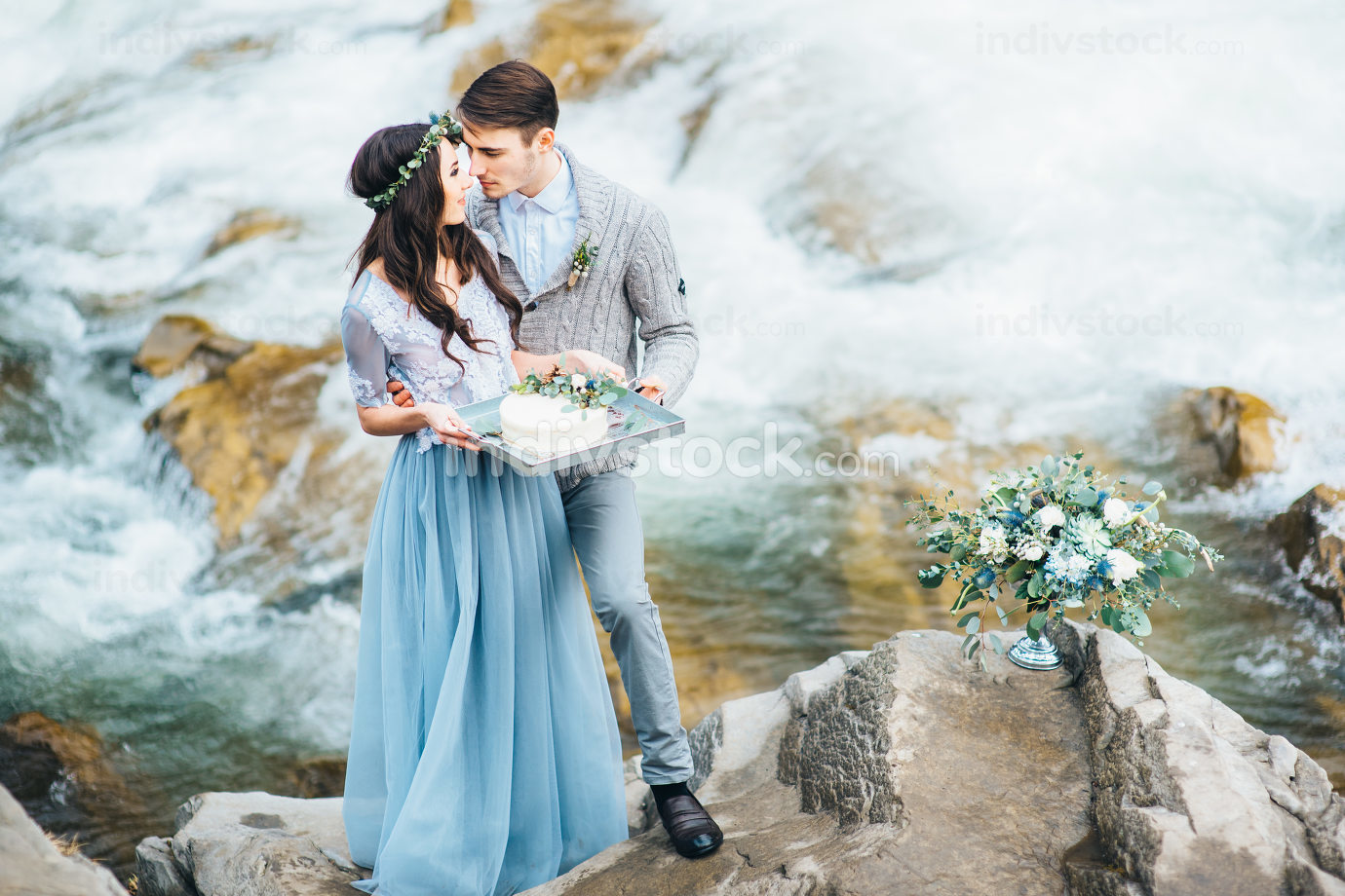 young couple in love on a mountain river