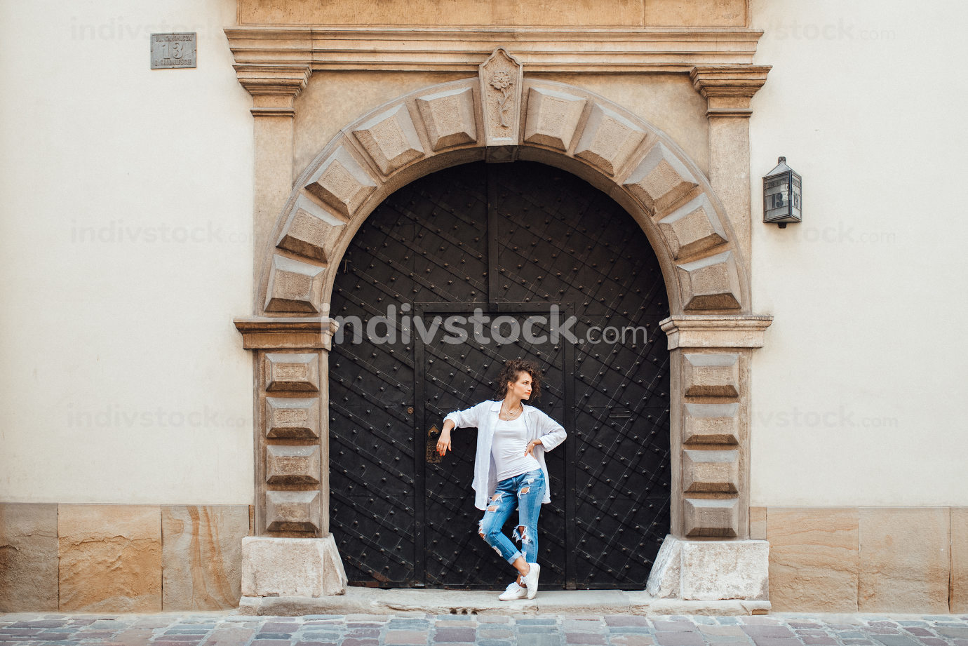 young girl walking on the old streets of europe